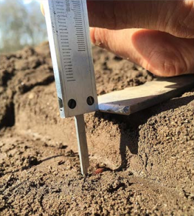Ploughing depth is measured using a caliper [picture taken from the thesis]